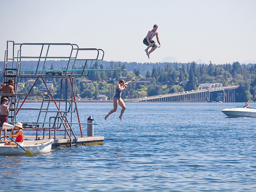Current photo of children jumping into Lake Washington.